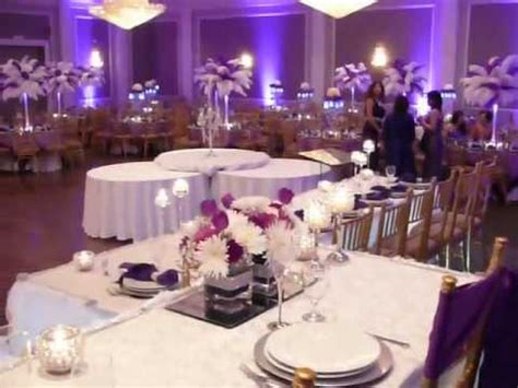 purple wedding decor. ostrich centerpieces. youtube