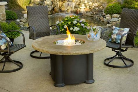 garden table and chairs with pit pit chairs and other equipment for barbecue