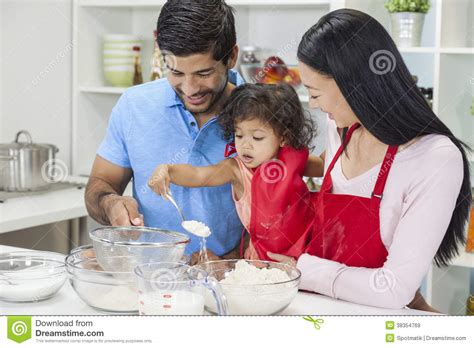 asian family cooking in home kitchen stock image