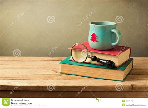 how many copies of a cup of christmas tea sold cup of tea and books on wooden table with copy space stock photo image 46571472