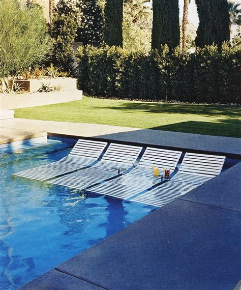 swimming pool deck lounge chairs transats dans la piscine sun loungers in the pool