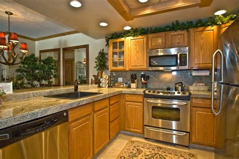 Countertops For Oak Cabinets by Countertops Light Oak Cabinets Above Kitchen Cabinets