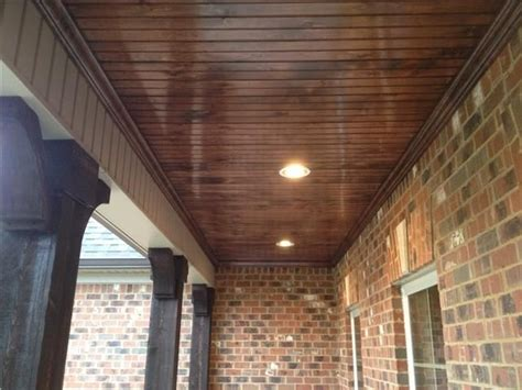 the bead board ceiling with can lights on the porch