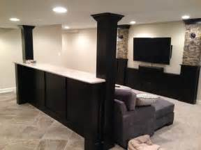 Basement built in cabinets and bars traditional basement