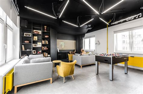 breakout room definition this new office interior uses wood and black frames to clearly define spaces contemporist