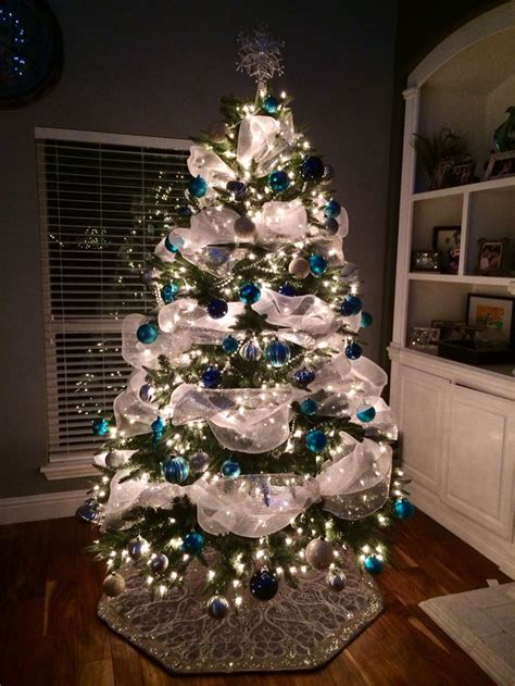 christmas tree with wide poly mesh garland blue white