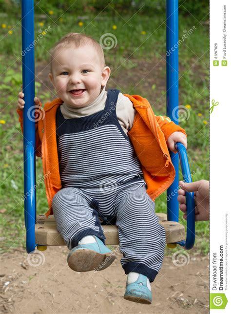 boy swing little boy riding on a swing royalty free stock photos