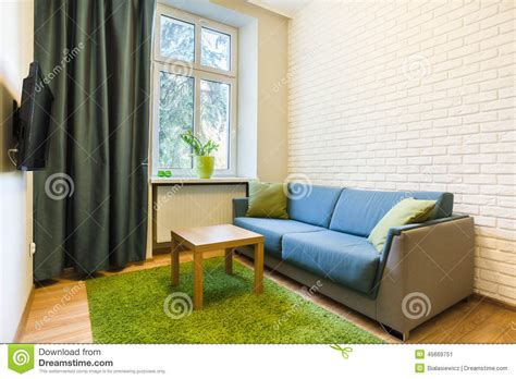 small comfortable couch comfortable couch in small flat stock photo image 45669751