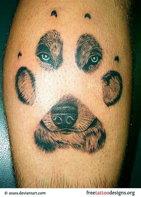 wolf face tattoo of a wolf through a paw print be expressive