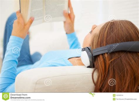 reading couch stock images young female relaxing on the couch reading a