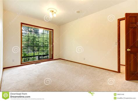 Free House Floor Plans empty white room with wood door and beige carpet royalty