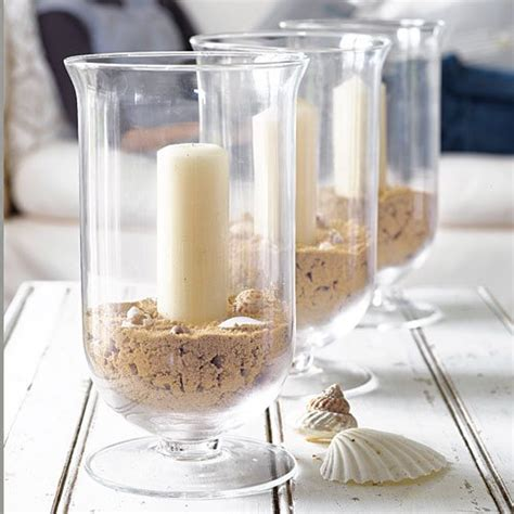 wedding centerpieces with candles and sand the candle holders for beachcombers bliss living