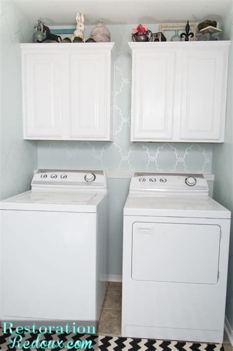 laundry room makeovers vintage cabinet turned laundry her daily dose of style