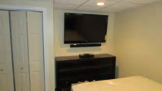 Tv wall mounting installing over fireplace amp in bedroom with soundbar