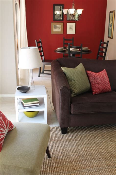 transitional style  sage green accents  red walls