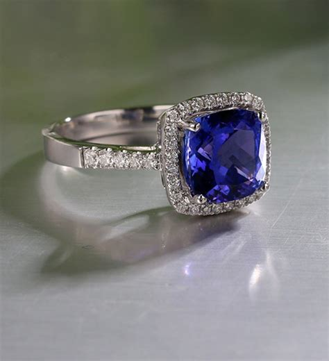 1 50 carat cushion cut blue sapphire and halo