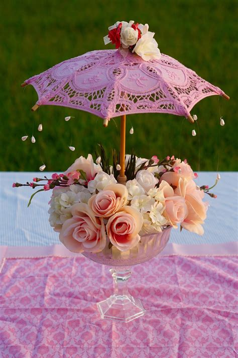 Oh So Cute Diy Parasol Garden Party Baby Shower Centerpiece Baby Shower Umbrella Centerpieces