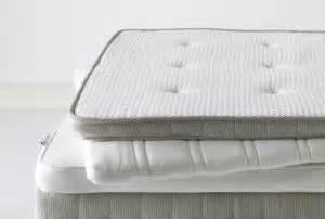 futon vs matratze discussing mattress pads vs toppers