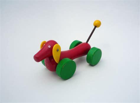 brio sweden vintage brio dachshund wooden toy red green and yellow dog