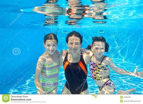 Family Swim Poll happy family swim underwater in pool royalty free stock image image 31682766