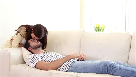 my husband sleeps on the couch pregnant woman relaxing with husband on sofa stock footage