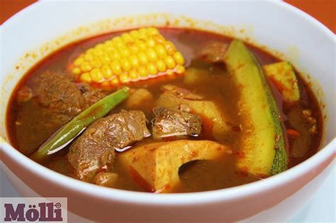 hearty slow cooker beef soup recipe molli