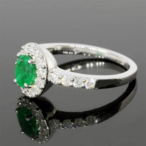 oval emerald halo white gold engagement ring for