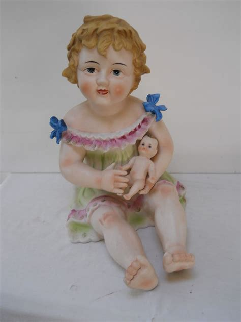 bisque piano doll vtg large piano baby figurine holding a doll bisque porcelain