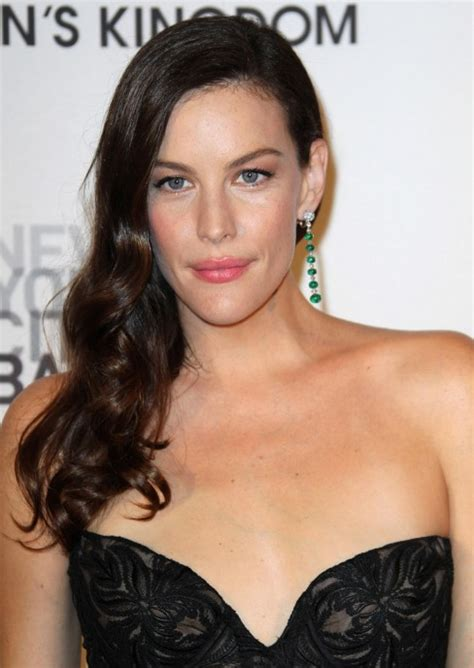 sideswept curled hairstyles for black women celebrity side parted wavy hairstyle from liv tyler sexy