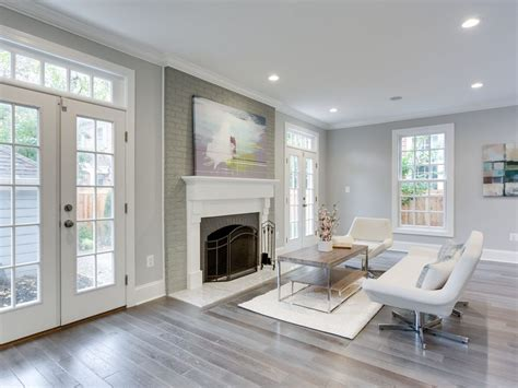show me contemporary living rooms living room with cement fireplace hardwood floors in