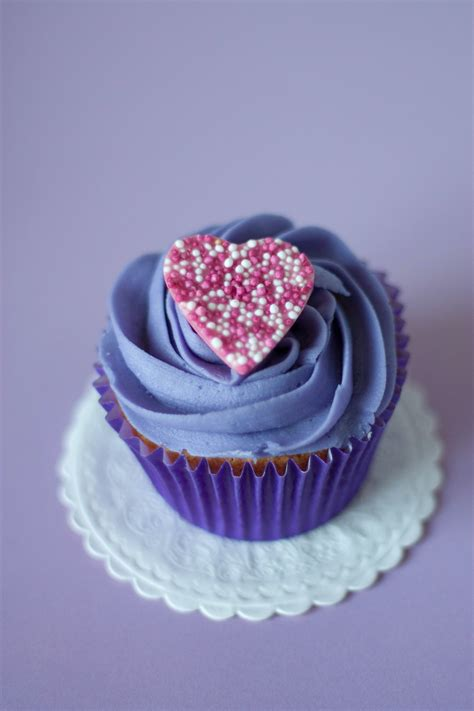 purple cupcake  heart frosting  stock photo