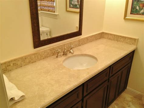 vanity backsplash to match travertine accent in tub http www lowcountrytile tile