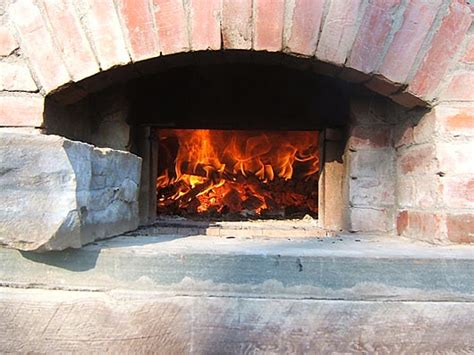 Oven The Baker baking breads in my brick oven