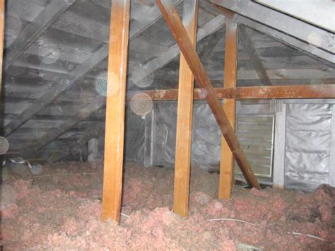 finish attic diy applying thermal barrier paint on an attic roofline