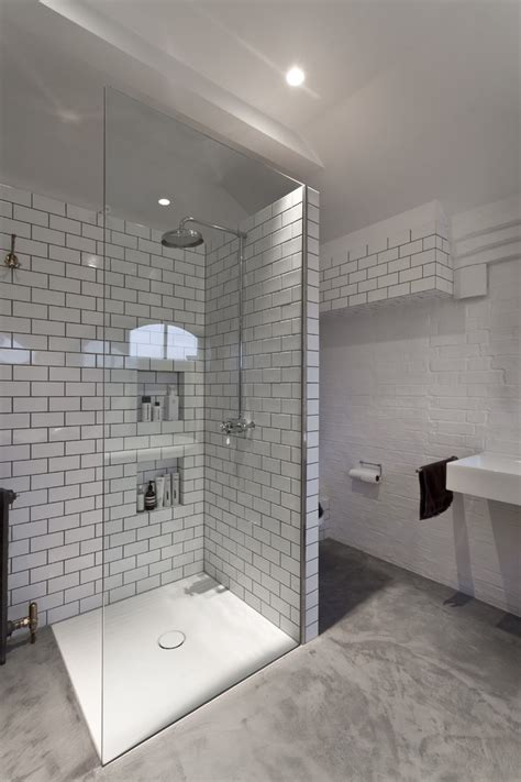 tiling a bathroom floor on concrete white subway tile bathroom contemporary with poured