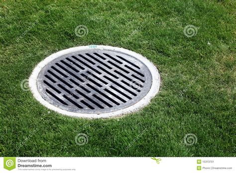 Drainase Manhole drain manhole surrounded by grass stock image image