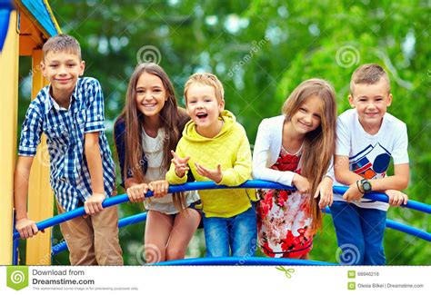 fun times at the new kids on the block concert masshole happy excited kids having fun together on playground stock