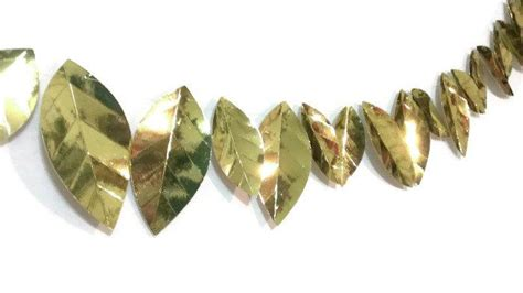 gold metallic leaf garland silver and gold holiday party