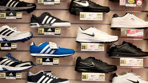 athletic shoe fitting stores adidas is going after nike where it hurts