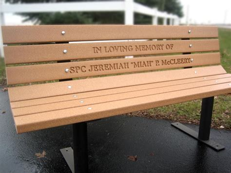 personalized memorial bench shown with routed lettering