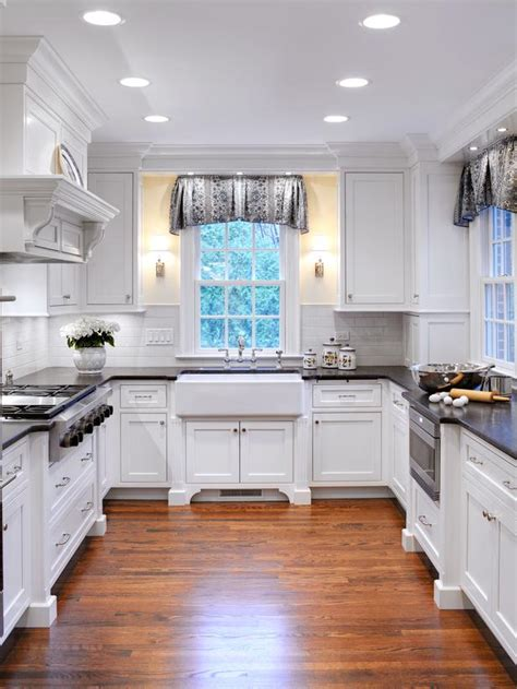 white traditional style kitchen with farmhouse sink hgtv
