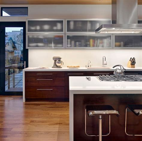 modern glass kitchen cabinets wooden lower cabinets and frosted glass upper cabinets bring in a perfect contrast decoist