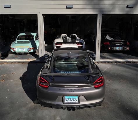 these beautiful porsche garages make us want to move in