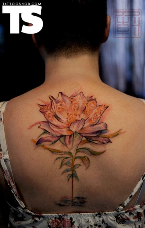 lotus tattoo hong kong i like the placement of this tattoo as opposed to the