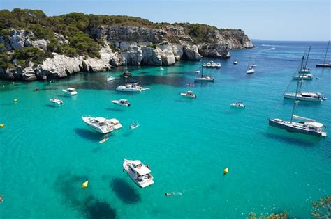 boat floating in water floating boat on the crystal clear water picture of cala
