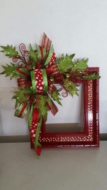 a cutie idea for a christmas picture fram alternative wreath made from a repurposed picture frame wreaths