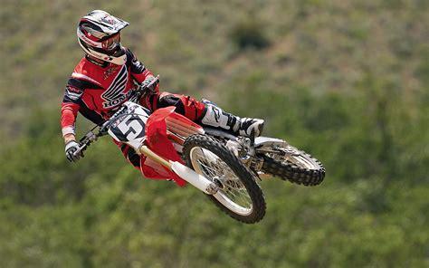 online motocross motocross riders doing stunt over live mma fight