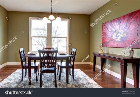 dining room with apple green walls and beautiful curtains beautiful nice dining room green walls stock photo