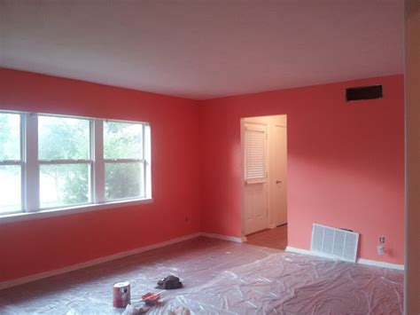 Coral Color Living Room by The Glam Nomad Living Room Paint