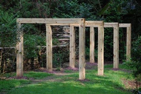 hand made minimalist pergola with adjacent rose arbor by